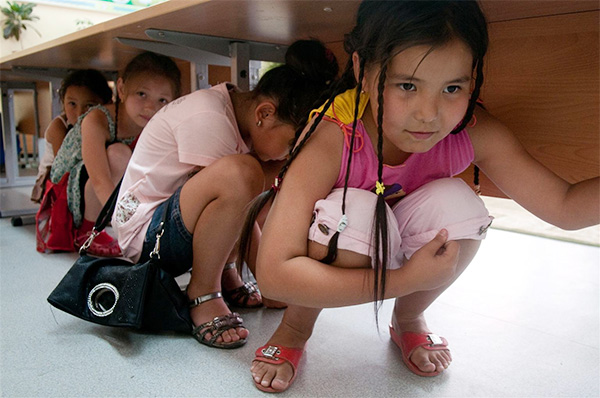 children hiding under a table
