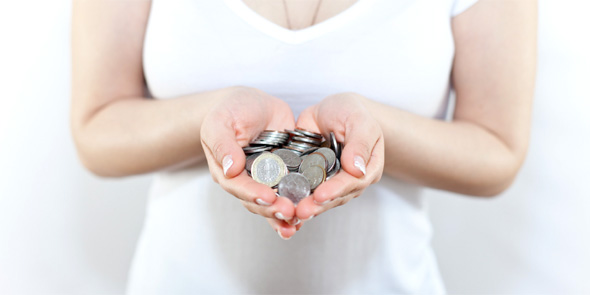 woman holding coins