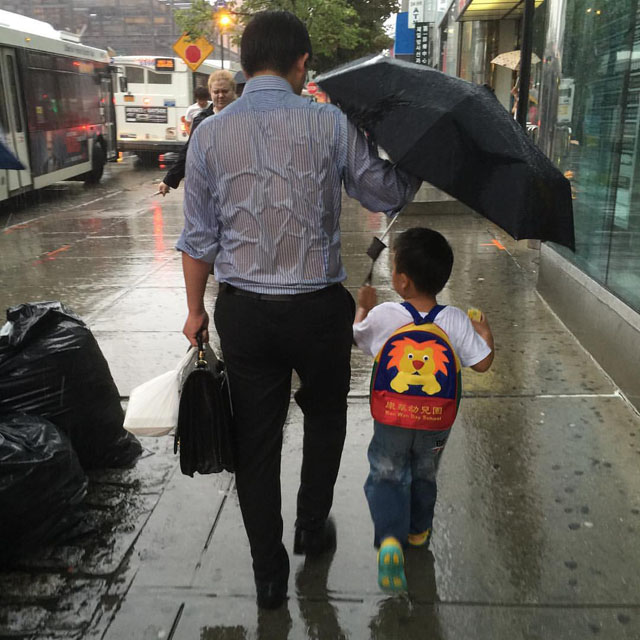 Umbrella Dad and son