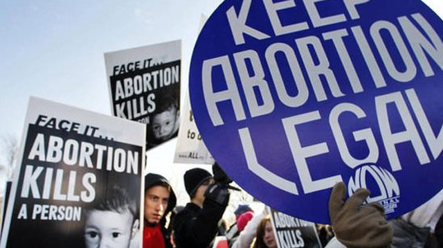 pro and anti abortion banners