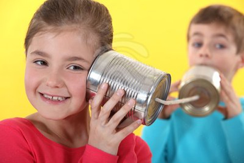 kids playing with tin can phones