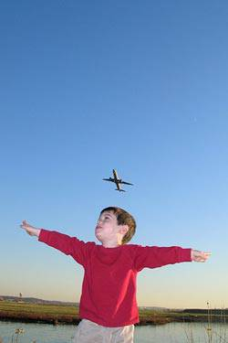 kid under airplane