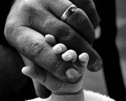 mother and baby's hands