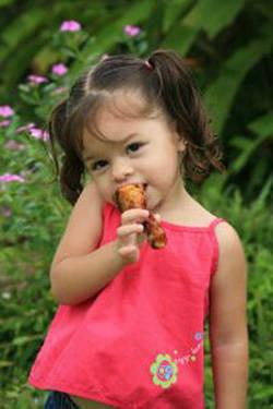 girl_eating_chicken_ci.jpg
