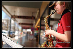 boy playing saxophone