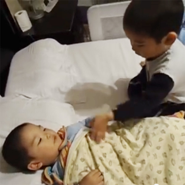 This Made our Day: Little Boy Tucks Baby Brother to Sleep
