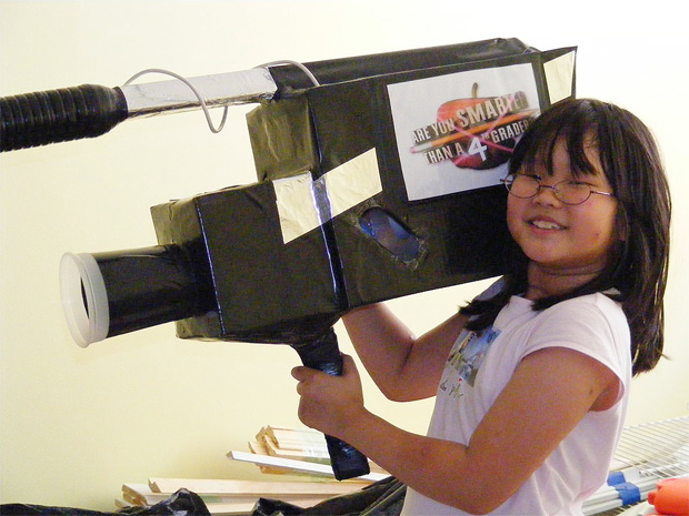 child with a cardboard camera