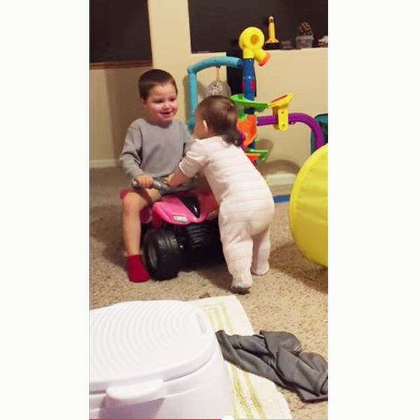This Made our Day: Boy Teaches Baby Sibling to Walk