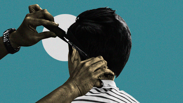 man giving men's haircut