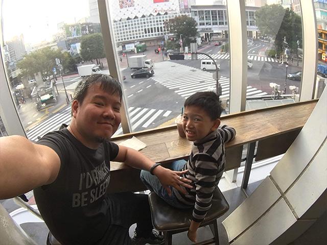 Mike Chang and his son Mico enjoying the early morning Shibuya Crossing.