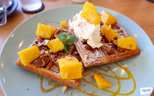 Little Wave Cafe waffles with mango, salted caramel, and coffee cream