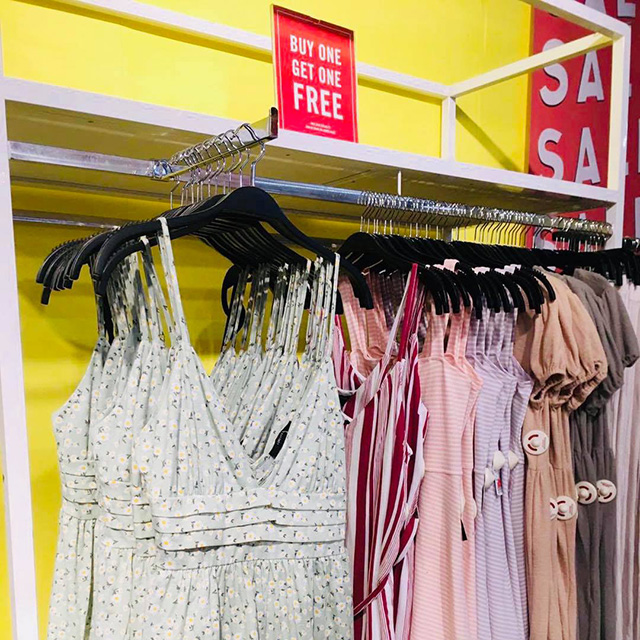 Dresses on display at Forever 21 with the Buy 1 Get 1 Free tag