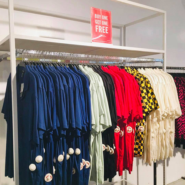 Blue tops and other clothing with the Buy 1 Get 1 Free tag at Forever 21