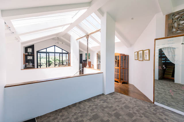 The skylight in the attic is the source of light streaming in from the topmost floor to the first floor