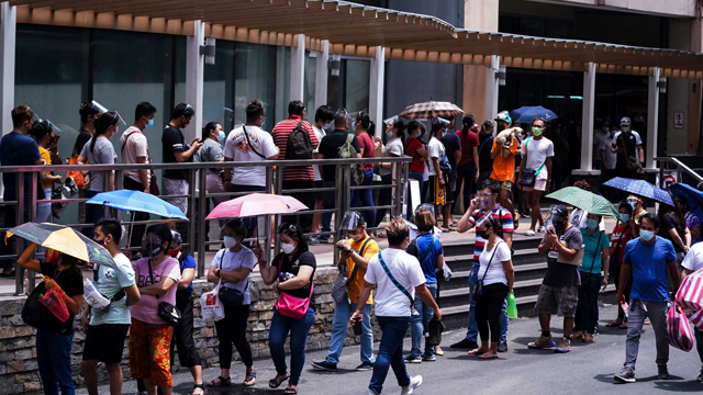 Economic frontliners (A4 priority group) line up for COVID-19 vaccines on June 8 at the Lucky Chinatown Mall in Manila