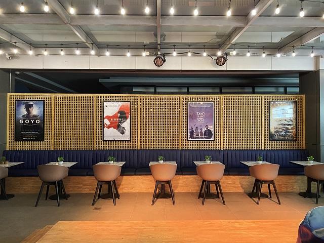 cinema '76 café interior includes movie poster