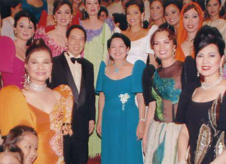 Fashion designer Pitoy Moreno and President Arroyo after a show