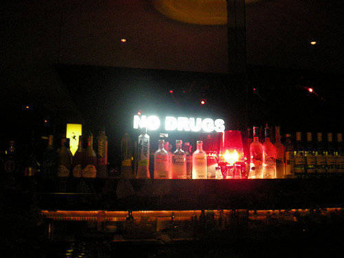 Illuminated sign at the bar stresses a point