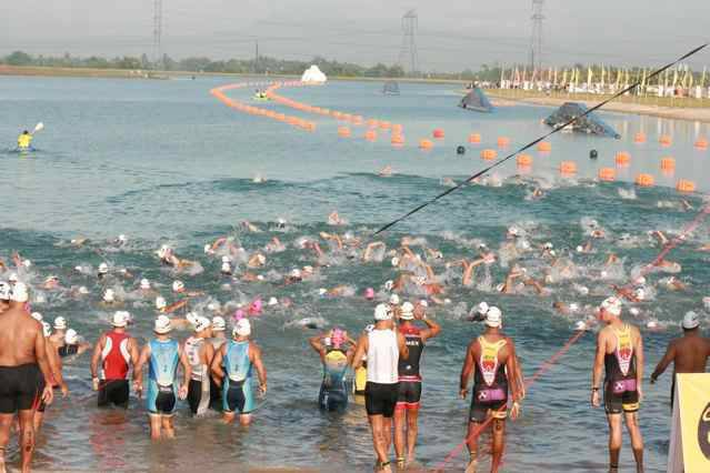 Ironman 73.0 competitors start the swim course, the first leg of the race. Photo by Gene Arthur Go