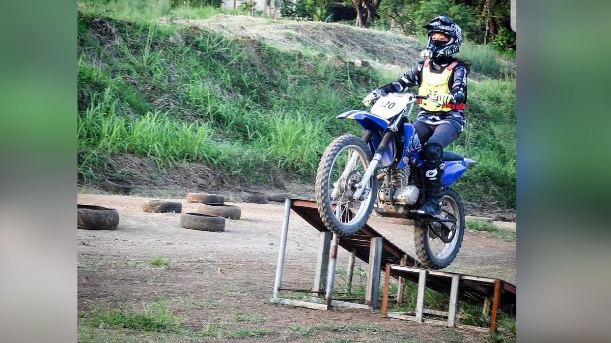 Che Estepa Riding the Motorcycle