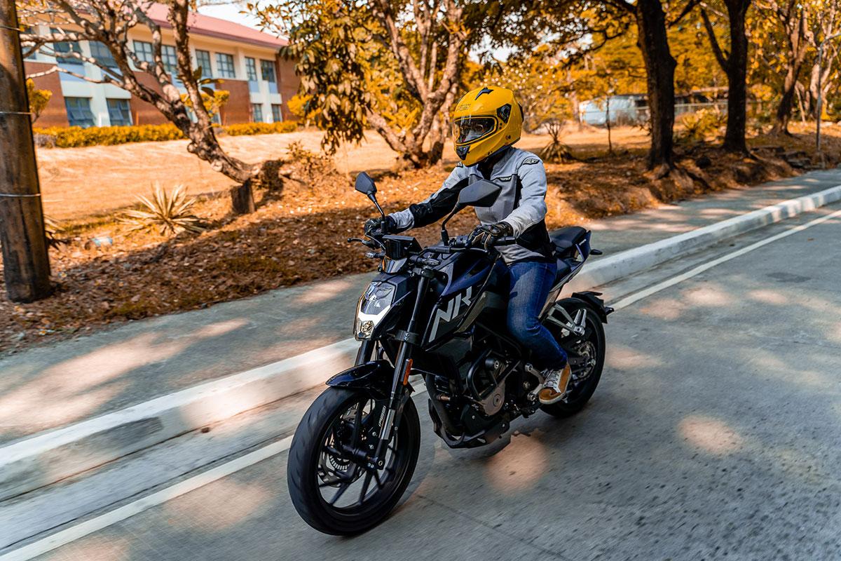 Man riding the CFMoto 300NK