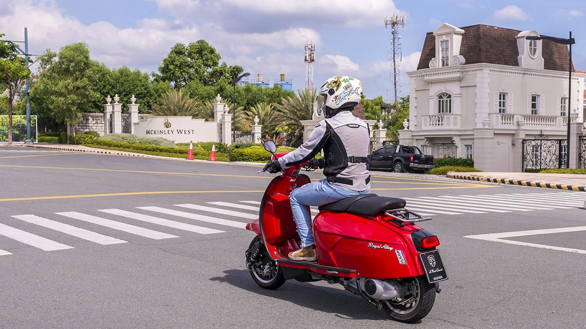 Man riding the 2021 Royal Alloy GP300S