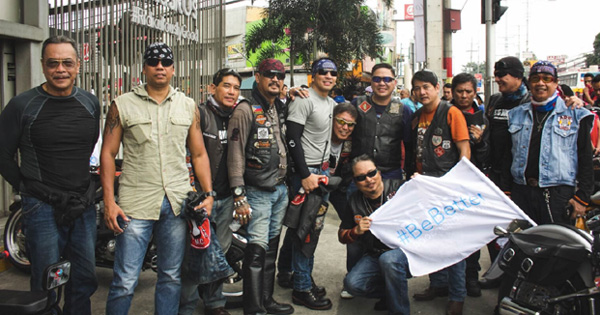 Harley-Davidson riders promote safety by giving out helmets