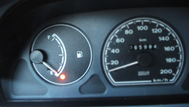 What should I do if my car runs out of fuel on the road?