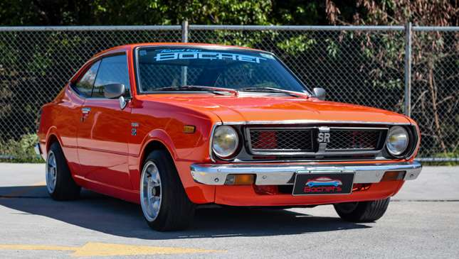 This orange Toyota Corolla SR is an old school pocket ...