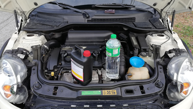 Should I use distilled water or coolant for my radiator?