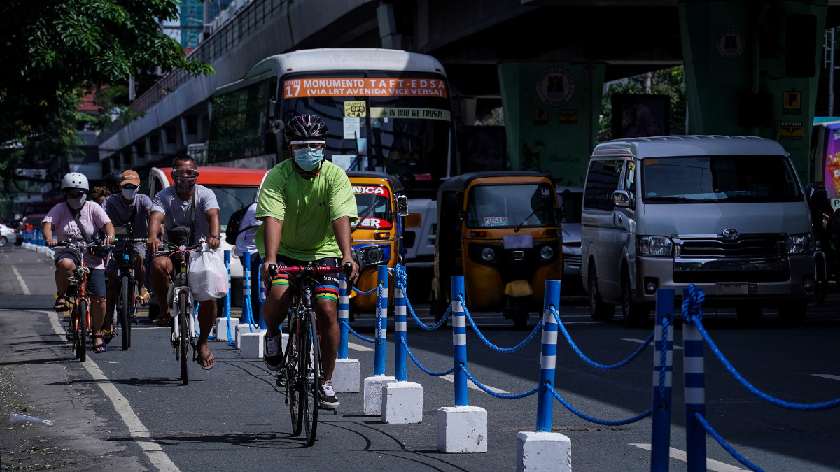A cyclist traversing EDSA through the designated bike lane