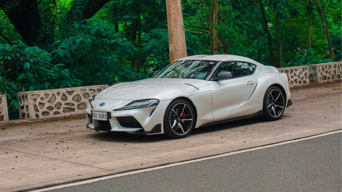 A front angled view of the Toyota GR Supra with a view of its side.