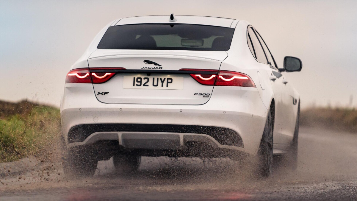 Jaguar XF P300 R-Dynamic - Rear View, On the Road Over Water