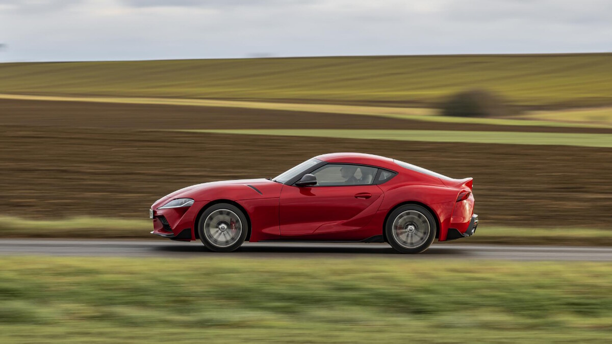 2021 Toyota Supra 2.0 profile view while on the road