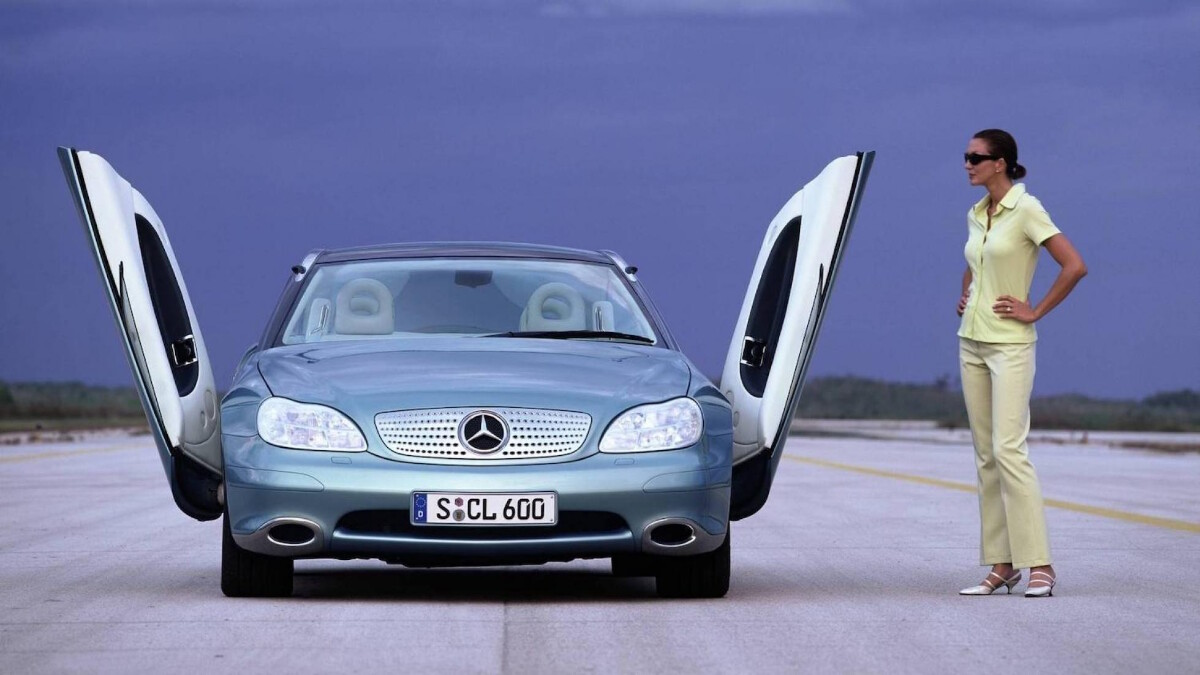 The Mercedes-Benz F200 Imagination with a person standing to its side