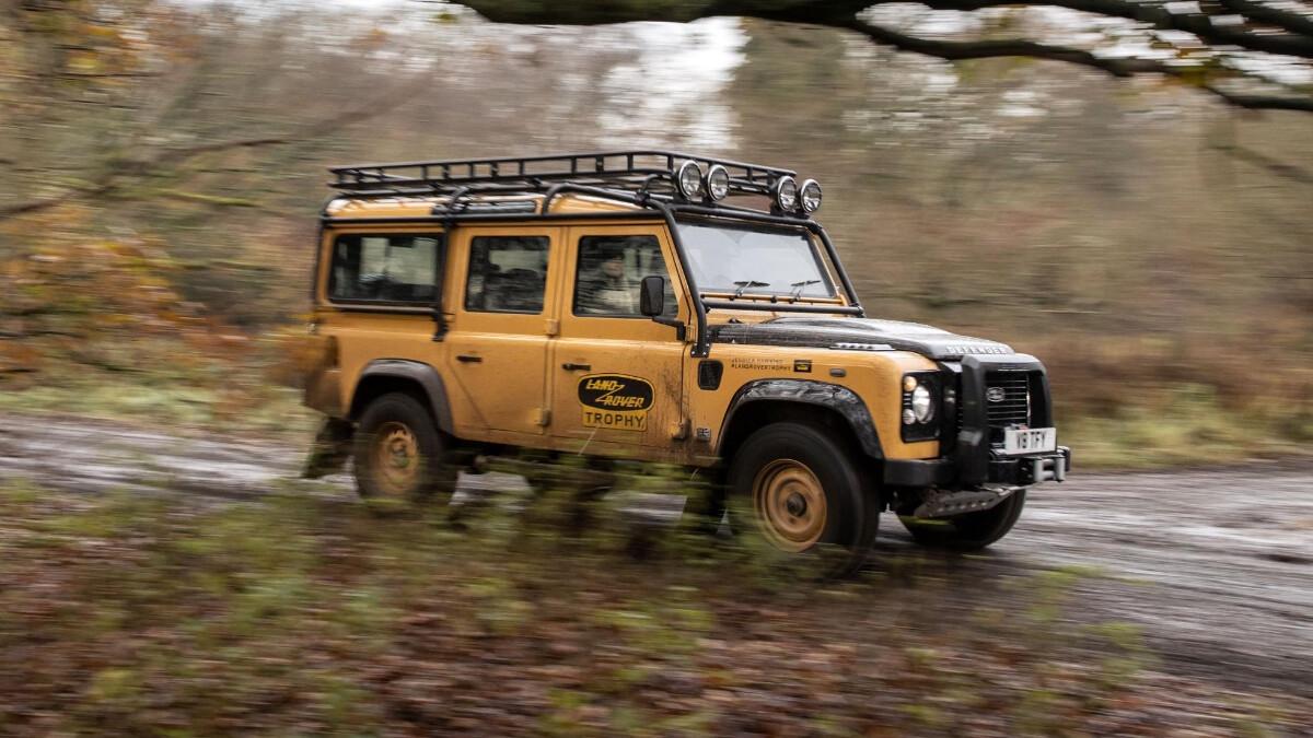 The Land Rover Defender V8 Trophy running over mud