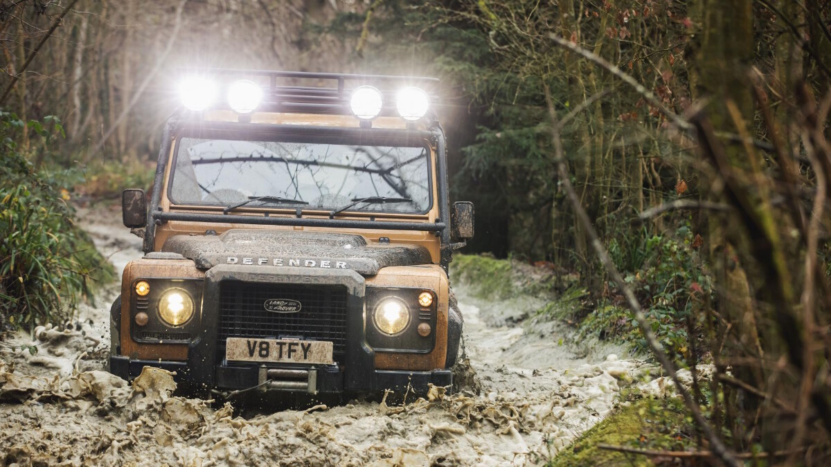 The Land Rover Defender V8 Trophy going through water