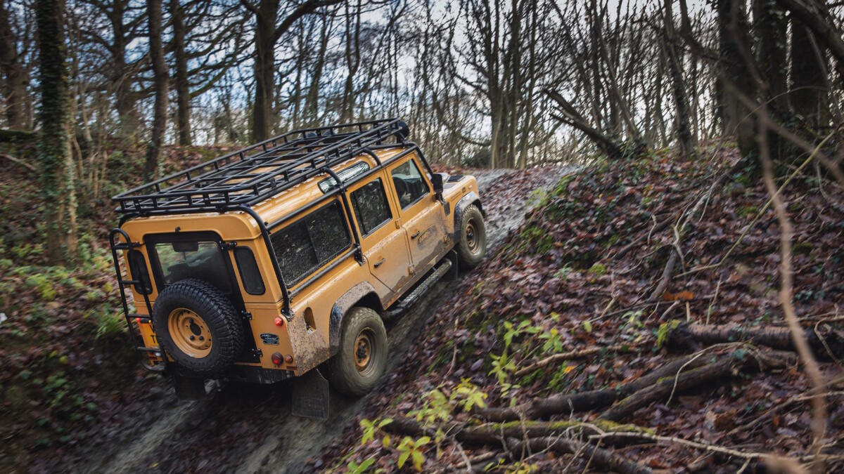 The Land Rover Defender V8 Trophy going up an incline