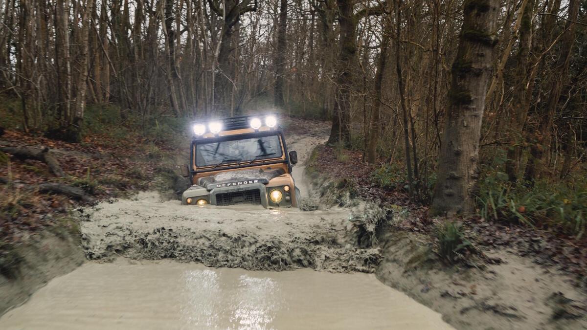The Land Rover Defender V8 Trophy on an offroad track