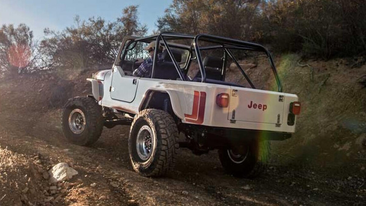 Jeep Scrambler by Legacy Classic Trucks climbing an incline