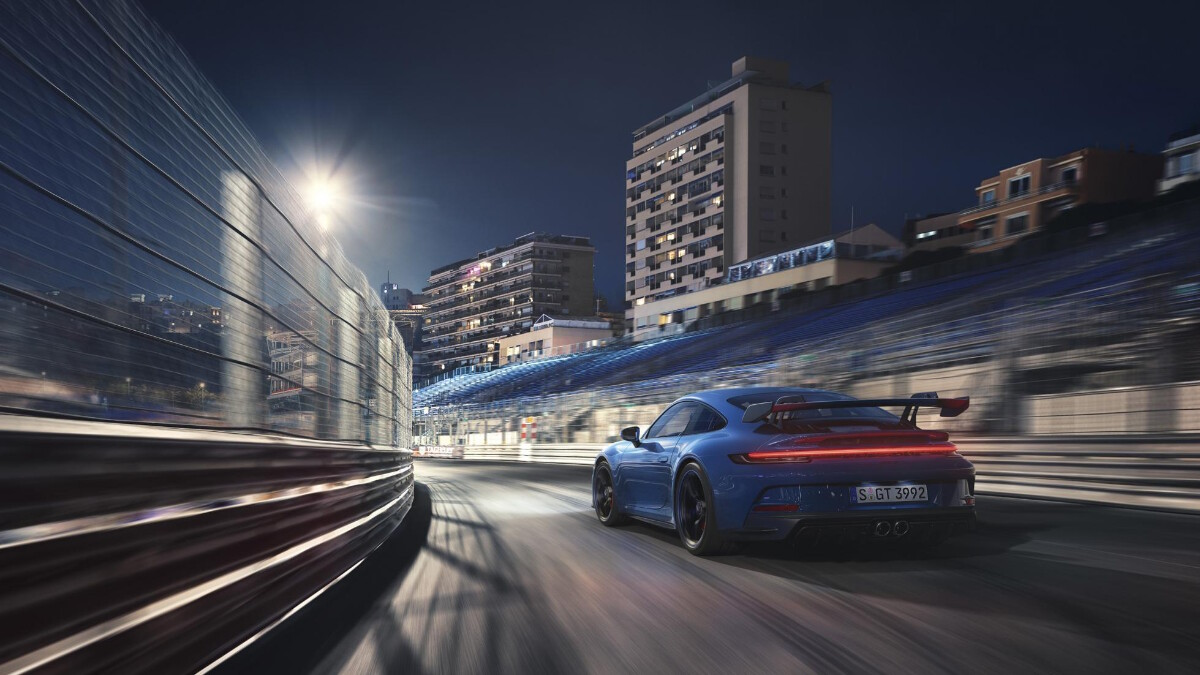 Porsche 911 GT3 rear view on the road at night