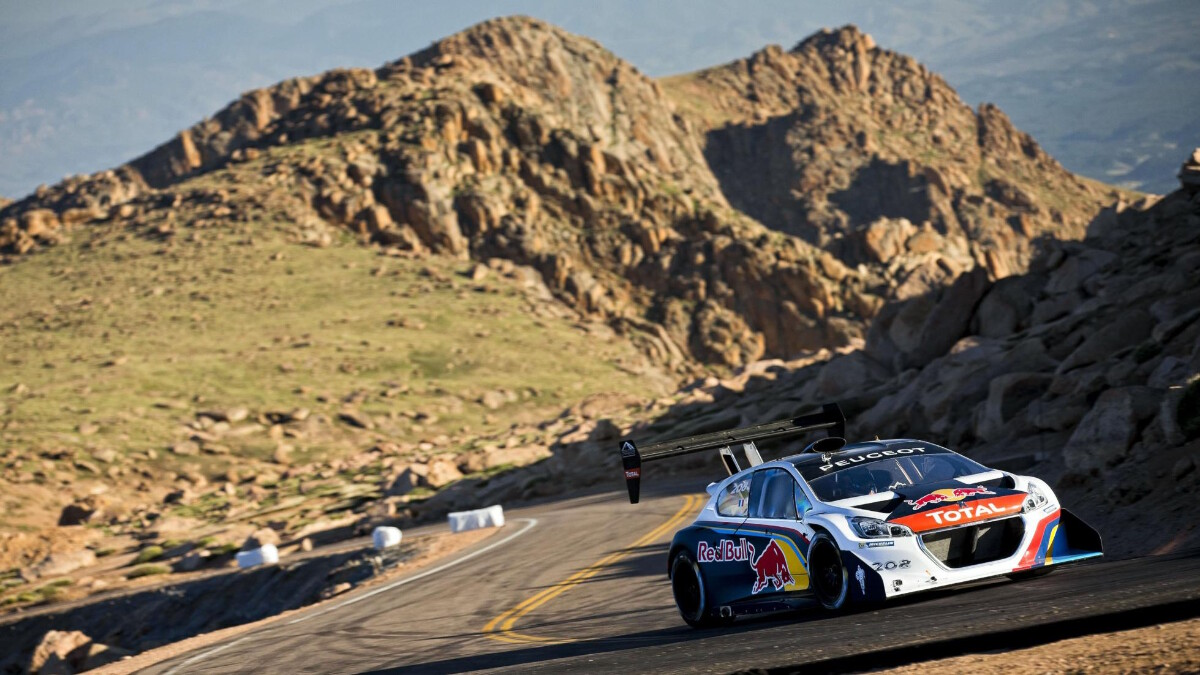 A racer climbing an slope from 2013's Pikes Peak International Hill Climb front view