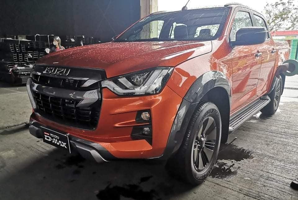 The Isuzu D-Max orange angled front view