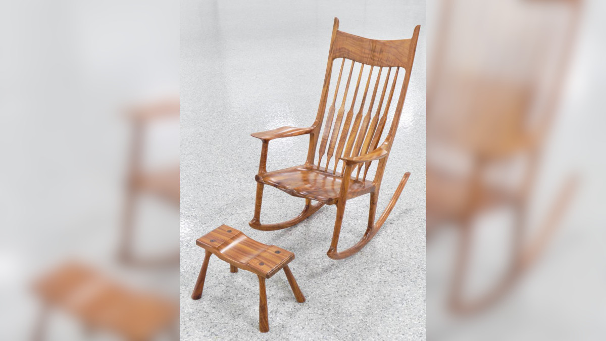 A set of chair and foot rest made of Koa wood