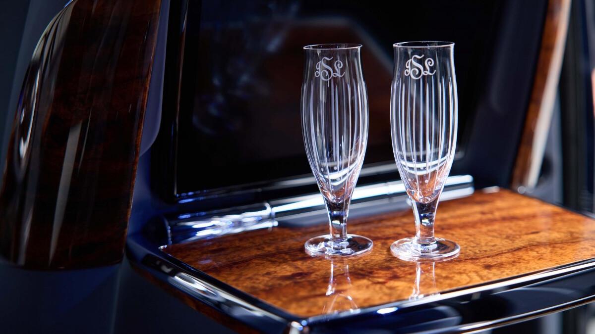 Rolls-Royce Phantom champagne glasses on a folding Koa wood table