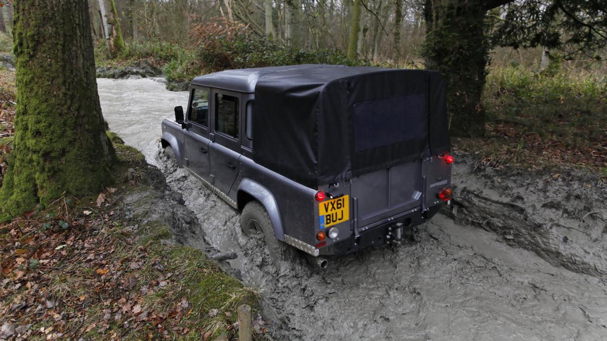 Land Rover Defender driving through mud