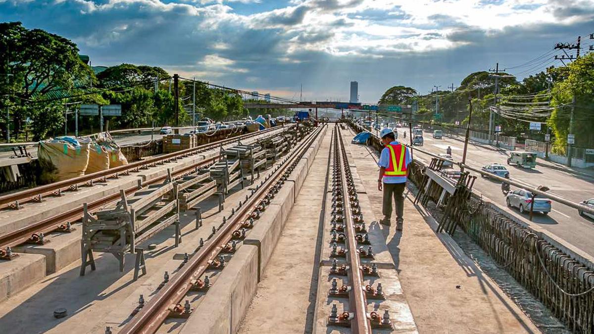 An inspector checking rails in an MRT-7 Depot