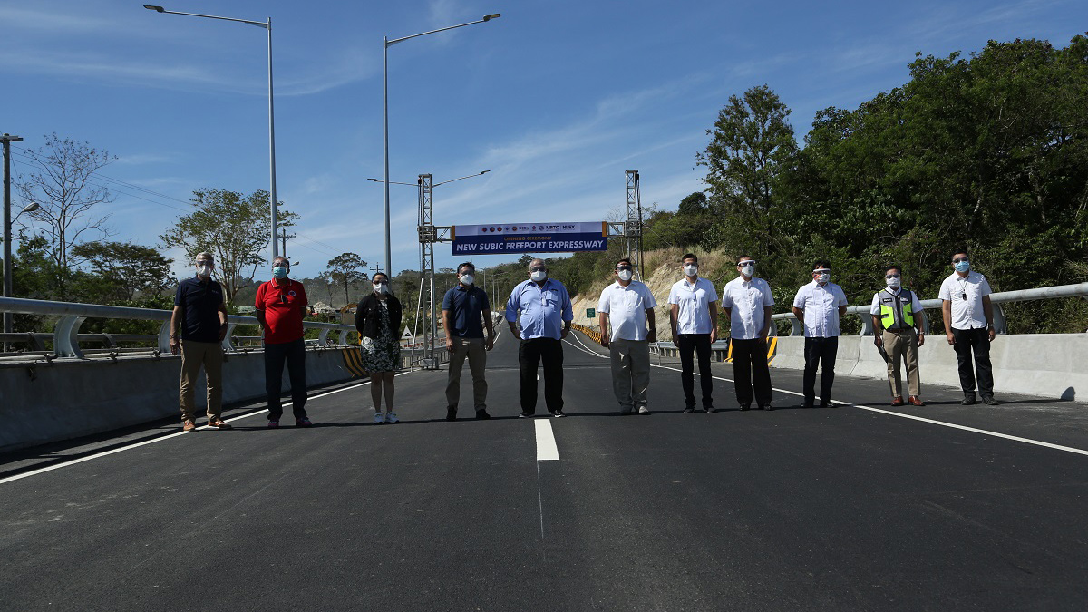 Members of the NLEX Corporation stand on the completed Subic Freeport Expressway