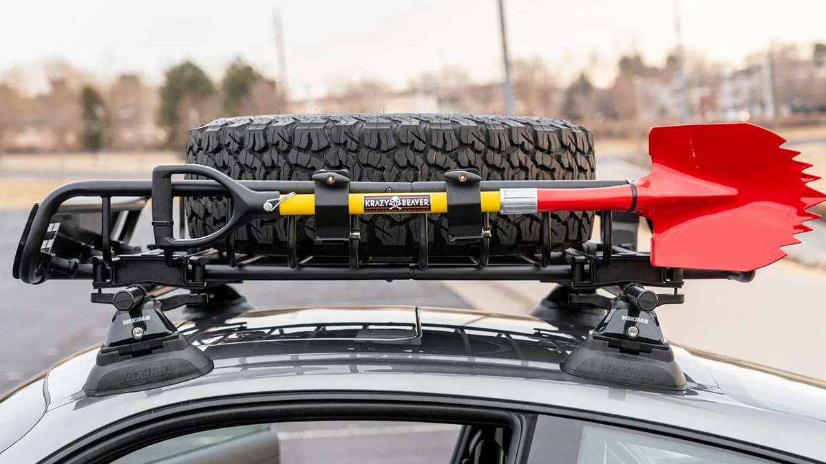 A Safari-Styled Porsche 911 top mounted spare tire and shovel