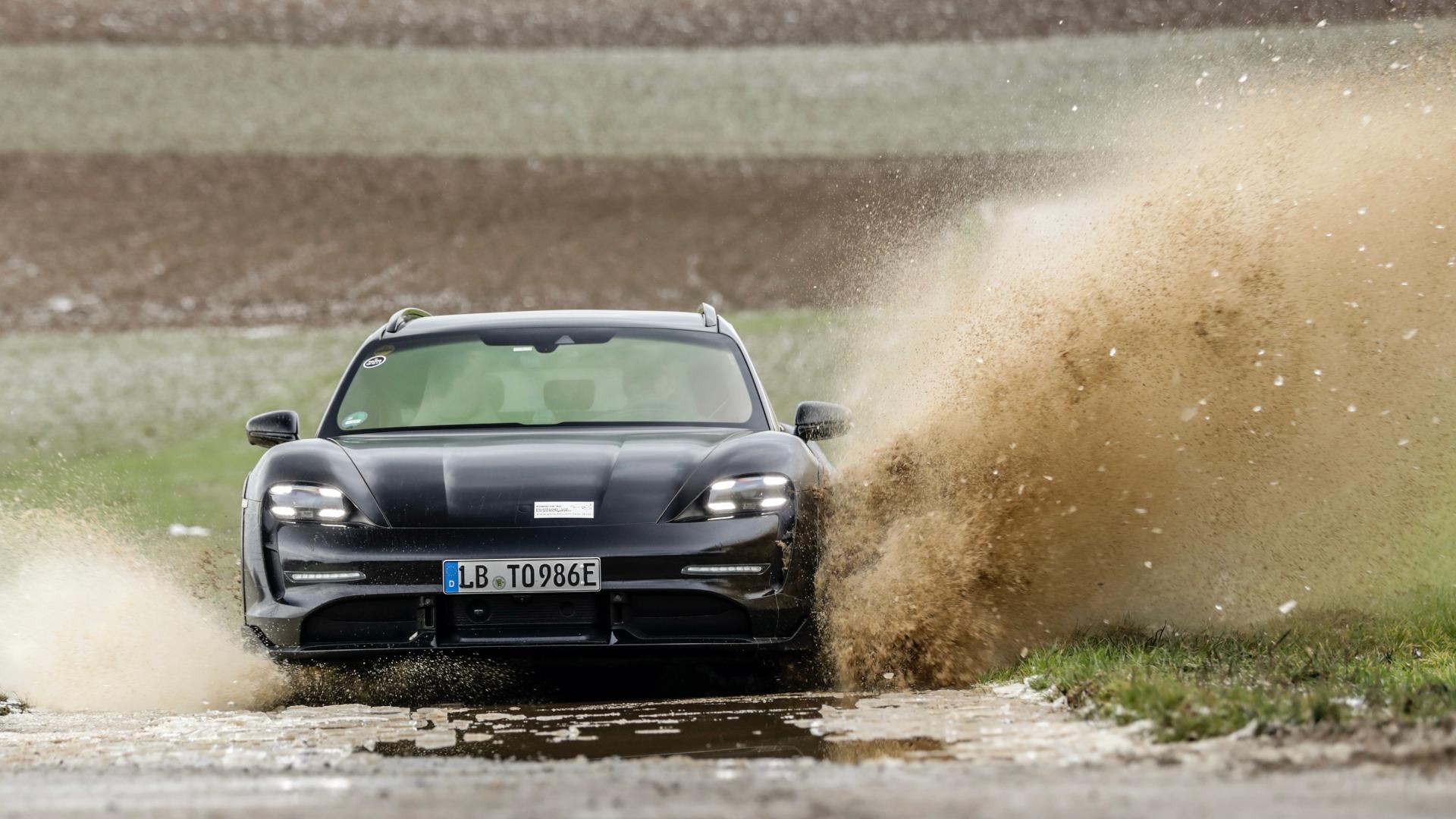 Porsche Taycan Cross Turismo running over water